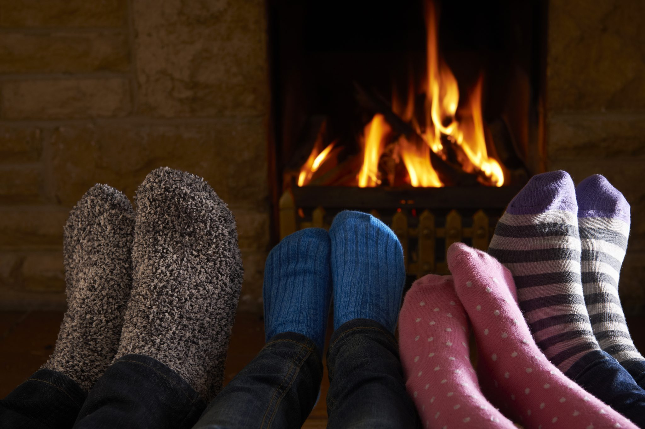 warm fuzzy socks by the fireplace
